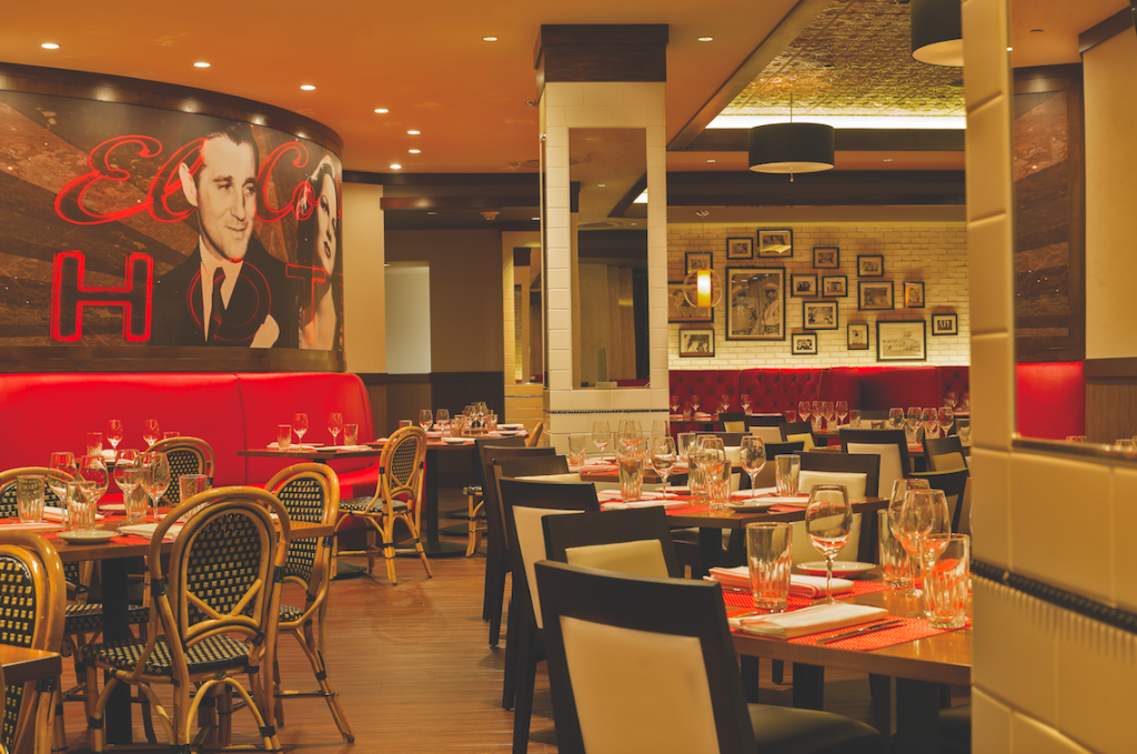 Restaurant interior with stylized photo of Bugsy Siegel on the wall